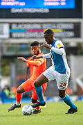 Elias Kachunga of Huddersfield Town chases Tosin Adarabioyo of Blackburn Rovers for the ball during the EFL Sky Bet Championship match between Blackburn Rovers and Huddersfield Town at Ewood Park, Blackburn, England on 19 October 2019.