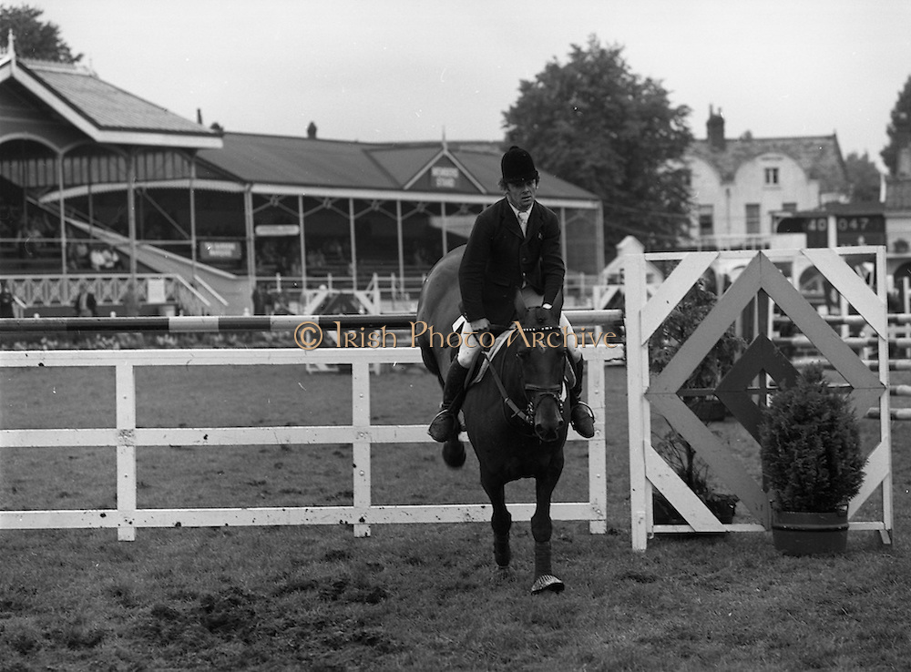 "07/08/1980<br /> 08/07/1980<br /> 07 August 1980<br /> R.D.S. Horse Show: John Player Top Score Competition, Ballsbridge, Dublin. Paul Darragh on ""P.J. Carroll""."