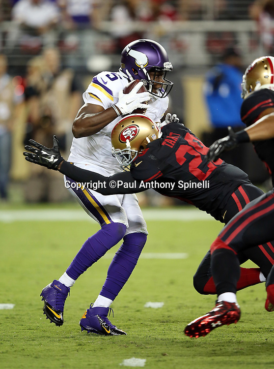 Minnesota Vikings quarterback Teddy Bridgewater (5) gets sacked on a third down play by San Francisco 49ers rookie strong safety Jaquiski Tartt (29) forcing a punt from the Vikings end zone during the 2015 NFL week 1 regular season football game against the San Francisco 49ers on Monday, Sept. 14, 2015 in Santa Clara, Calif. The 49ers won the game 20-3. (©Paul Anthony Spinelli)