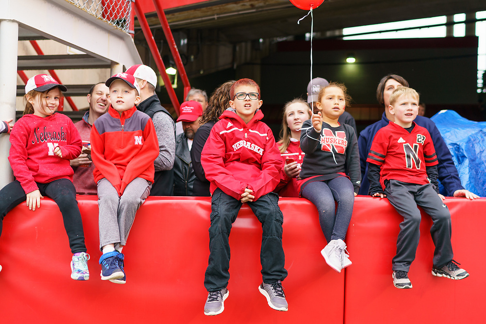 Young fans sit on the field wall during Nebraska's annual Spring Game at Memorial Stadium in Lincoln, Neb., on April 21, 2018. © Aaron Babcock