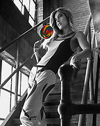 Selective color photo of model Elodie Tusac with lolliopoo in abandoned factory.