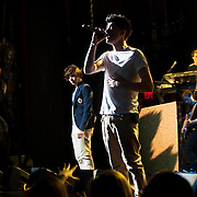 May 26, 2012 - New York, NY :  Zayn Malik, foreground, and Harry Styles, at left, of pop group 'One Direction' perform to a sold-out crowd at the Beacon theater in Manhattan on  Saturday afternoon. The group is on the road for their first-ever headlining North American tour in support of their debut album UP ALL NIGHT. CREDIT: Karsten Moran for The New York Times