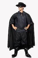 Full length of young man dressed as Zorro against gray background