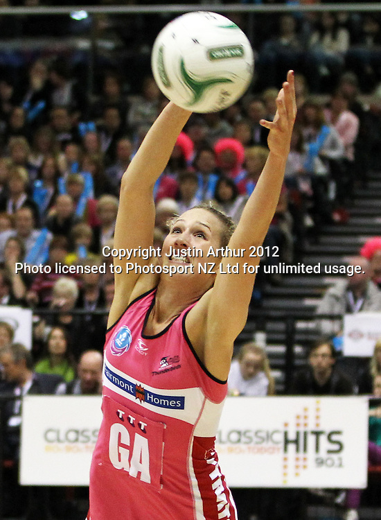Thunderbirds' Erin Bell gathers the ball during the ANZ Netball Championship, Haier Pulse v Adelaide Thunderbirds at TSB Bank Arena, Wellington, New Zealand on Monday 21 May 2012. Photo: Justin Arthur / photosport.co.nz