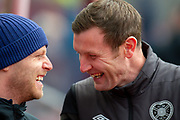 Heart of Midlothian coach Andy Kirk (right) shares a joke with Steven Naismith (#14) of Heart of Midlothian FC before the Ladbrokes Scottish Premiership match between Heart of Midlothian FC and St Johnstone FC at Tynecastle Park, Edinburgh, Scotland on 14 December 2019.