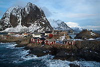 The bridge that leads from Hamnoy to Reine on Lofoten offers an amazing platform to look back onto the huts of Eliassen Rorbuer. The sea was coming in strong on the morning this was taking - pounding away at the rock wall that the huts are built upon.