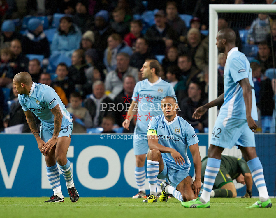 MANCHESTER, ENGLAND - Tuesday, Octover 18, 2011: Manchester City's captain Vincent Kompany looks dejected after Villarreal CF's first goal during the UEFA Champions League Group A match at the City of Manchester Stadium. (Pic by Vegard Grott/Propaganda)