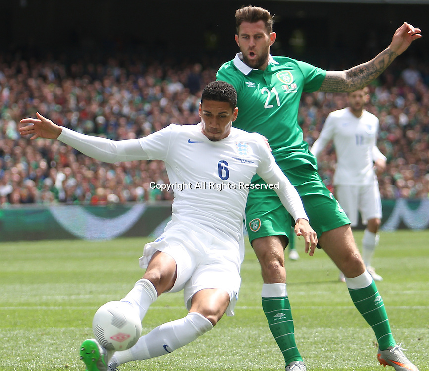 07.06.2015.  Dublin, Ireland. International Football Friendly. Republic of Ireland versus England. Chris Smalling clears the ball under pressure from Daryl Murphy.