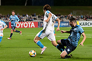SYDNEY, AUSTRALIA - MAY 21: Kawasaki Frontale player Manabu Saito (19) gets the ball past Sydney FC player Patrick Scibilio (34) at AFC Champions League Soccer between Sydney FC and Kawasaki Frontale on May 21, 2019 at Netstrata Jubilee Stadium, NSW. (Photo by Speed Media/Icon Sportswire)