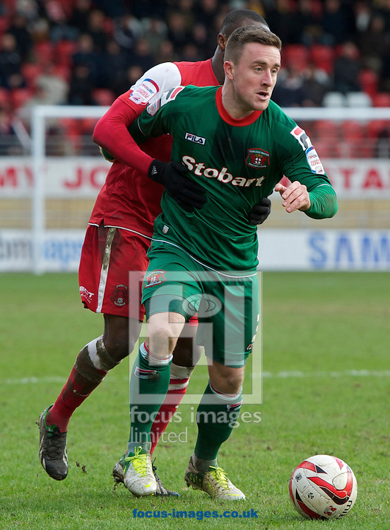 Picture by Alan Stanford/Focus Images Ltd +44 7915 056117.16/03/2013.Moses Odubajo of Leyton Orient (L) and Matt Robson of Carlisle United during the npower League 1 match at the Matchroom Stadium, London..