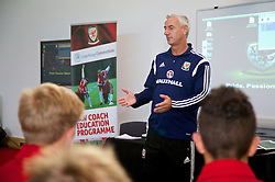 NEWPORT, WALES - Wednesday, September 24, 2014: Wales' coach Ian Rush speaks to the players in a team meeting after training at Dragon Park ahead of the Under-16's International Friendly match against France. (Pic by David Rawcliffe/Propaganda)