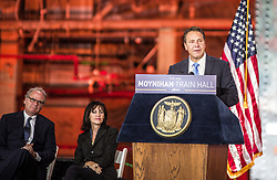 August 17, 2017 - New York, New York, U.S. - Governor ANDREW CUOMO and MAURA MOYNIHAN, seated center, the daughter of former senator of New York Daniel Patrick Moynihan, dedicate the new Moynihan Train Hall.  The new hall is under the postal service building behind New York Penn Station's 8th Avenue side and is a crucial piece of development designed to help sustain development of the city's far west side. (Credit Image: © Sachelle Babbar via ZUMA Wire)