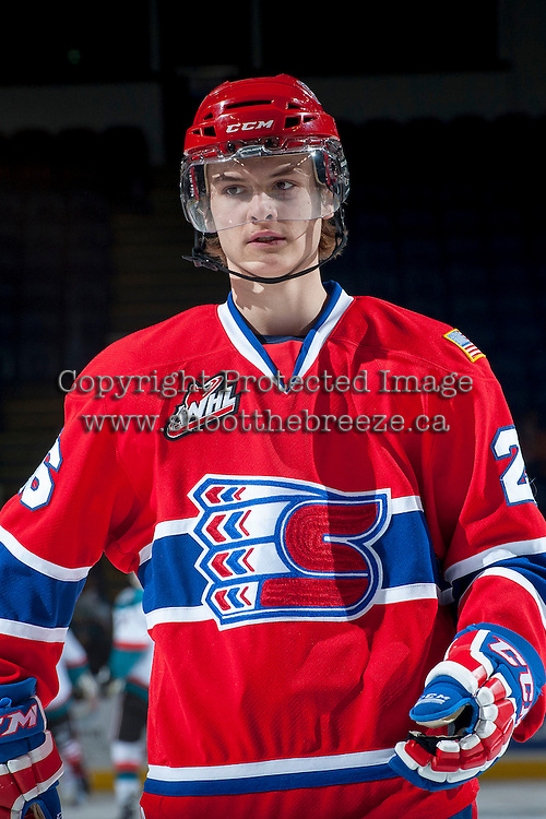 KELOWNA, CANADA -JANUARY 29: Hudson Elynuik LW #26 of the Spokane Chiefs skates during warm up against the Kelowna Rockets on January 29, 2014 at Prospera Place in Kelowna, British Columbia, Canada.   (Photo by Marissa Baecker/Getty Images)  *** Local Caption *** Hudson Elynuik;