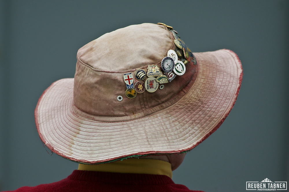 © Reuben Tabner. .Emirates Durham ICG, Durham, UK  23/04/11. LV= County Championship - Durham ccc v Sussex CCC. A battered and tired looking sun hat, covered in cricket pins protects an elderly gents head from the burning sun.
