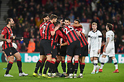 AFC Bournemouth forward Dominic Solanke (9) is congratulated by his teammates after scoring his first goal for the club during the The FA Cup match between Bournemouth and Luton Town at the Vitality Stadium, Bournemouth, England on 4 January 2020.