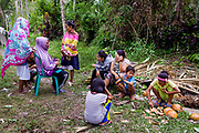 Villagers socialise at a coconut farm turned into a shelter.  1500 people were displaced and found shelter in Langaoge coconut farm when a powerful  7.5 earthquake magnitude struck off the coast of Donggala (epicentre) Central Sulawesi, Indonesia on Sept. 28th causing a tsunami and destroying many homes.