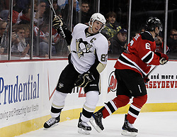 Dec 30, 2009; Newark, NJ, USA; Pittsburgh Penguins center Sidney Crosby (87) reacts to a no-call after a hit by New Jersey Devils defenseman Andy Greene (6) during the first period at the Prudential Center.