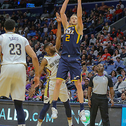 Mar 11, 2018; New Orleans, LA, USA; Utah Jazz forward Joe Ingles (2) shoots and draws a foul from New Orleans Pelicans guard Ian Clark (2) during the second half at the Smoothie King Center. Mandatory Credit: Derick E. Hingle-USA TODAY Sports