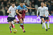 Liverpool defender Andrew Robertson (26) battles for possession with West Ham United midfielder Robert Snodgrass (11) during the Premier League match between West Ham United and Liverpool at the London Stadium, London, England on 29 January 2020.