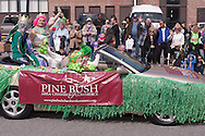 Pine Bush, New York - People dressed as aliens drive down Main Street during the parade at the Pine Bush UFO Fair on  on April 26, 2014.