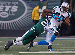 Nov 29, 2009; East Rutherford, NJ, USA; Carolina Panthers wide receiver Muhsin Muhammad (87) is tackled by New York Jets cornerback Lito Sheppard (26) after making a catch during the first half at Giants Stadium.