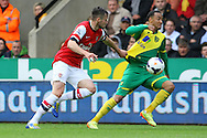 Carl Jenkinson of Arsenal and Nathan Redmond of Norwich in action during the Barclays Premier League match at Carrow Road, Norwich<br /> Picture by Paul Chesterton/Focus Images Ltd +44 7904 640267<br /> 11/05/2014
