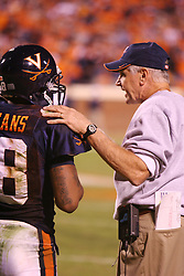 UVA head coach Al Groh consults with Marques Hagans (18) against FSU.  The Virginia Cavaliers defeated the #4 ranked Florida State University Seminoles 26-21 on October 15, 2005 at Scott Stadium in Charlottesville, VA.