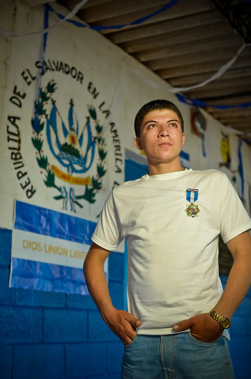 "Marcos Menjivar, 20, poses for a portrait at Canton El Zapotal school in Chalatenango, El Salvador. In 2010, when he was 18 years old, Menjivar was part of a group of students, trained in disaster response by the international ngo, Plan UK, that took charge of rescuing 80 elderly and mobility impaired residents of his community when a mudslide destroyed their homes.  For his efforts, he was awarded a medal from the National Civilian Protection Commission.  When asked how he felt when his heroism was rewarded, he said: ""In the beginning we were completely surprised because we never thought we would be rewarded for doing something that we thought it was our duty to do. We never expected to get any type of recognition. We did it to help people, to help our community."""