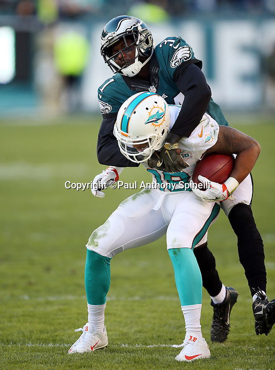 Philadelphia Eagles cornerback Byron Maxwell (31) tackles Miami Dolphins wide receiver Rishard Matthews (18) on a second quarter pass reception for a gain of 9 yards during the 2015 week 10 regular season NFL football game against the Miami Dolphins on Sunday, Nov. 15, 2015 in Philadelphia. The Dolphins won the game 20-19. (©Paul Anthony Spinelli)