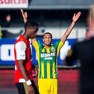 DEN HAAG, ADO Den Haag - Feyenoord, voetbal, Eredivisie seizoen 2015-2016, 1-11-2015, Kyocera Stadion, ADO Den Haag speler Gianni Zuiverloon (M) is blij met de overwinning, Feyenoord speler Terence Kongolo (L) baalt.