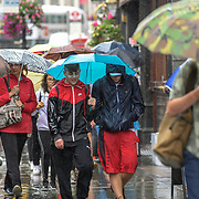 UK Weather:  Pedestrians holding umbrella in Rainy London, UK. 19 July 2019.