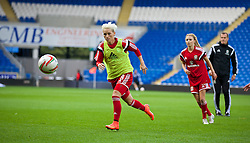 CARDIFF, WALES - Tuesday, August 21, 2014: Wales' captain Jessica Fishlock warms-up before the FIFA Women's World Cup Canada 2015 Qualifying Group 6 match against England at the Cardiff City Stadium. (Pic by David Rawcliffe/Propaganda)