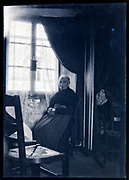 elderly woman sitting comfortable by the window indoors France circa 1930s