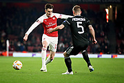 Arsenal's Carl Jenkinson (25) takes on Qarabag FK's Maksim Medvedev (5) during the Europa League group stage match between Arsenal and FK QARABAG at the Emirates Stadium, London, England on 13 December 2018.