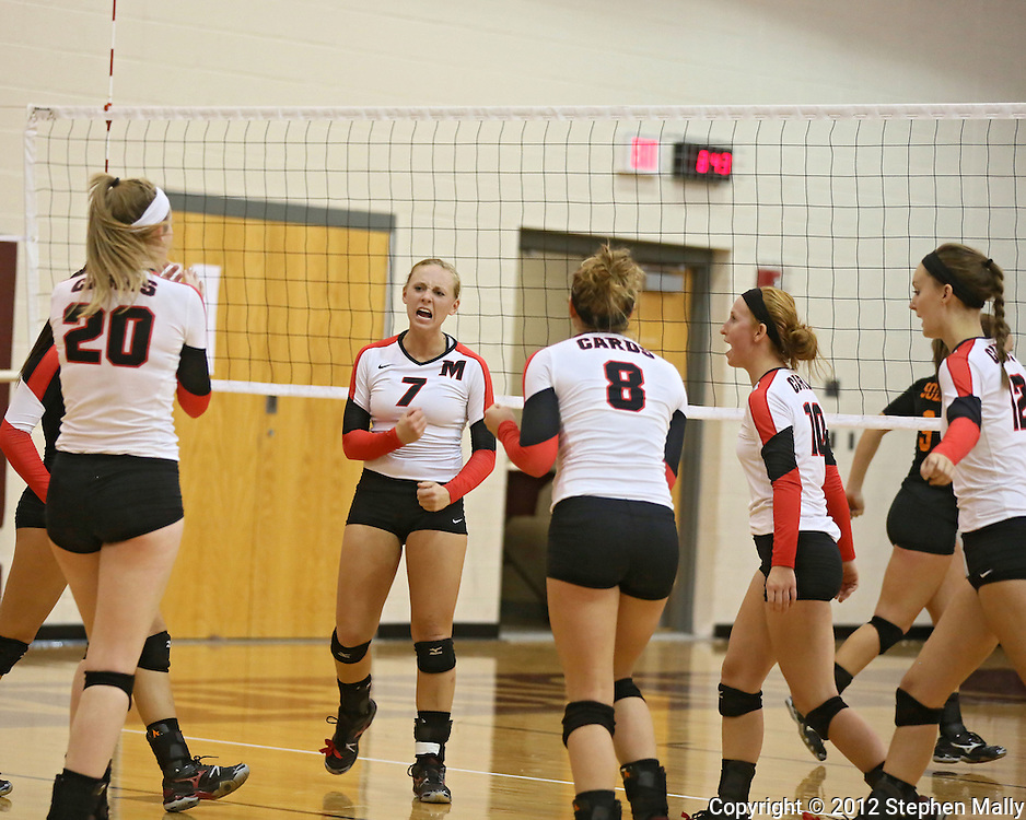 Maquoketa's Erica Sutton (7) is pumped up after a score during the WaMaC Tournament Championship game at Mount Vernon High School in Mount Vernon on Thursday October 11, 2012. Solon defeated Maquoketa 17-25, 25-15, 15-10.