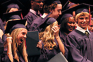 Students turn their tassels during the Miami Valley School 39th annual commencement at the Victoria Theatre in downtown Dayton, June 7, 2012.
