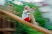 Child slipping down a slide