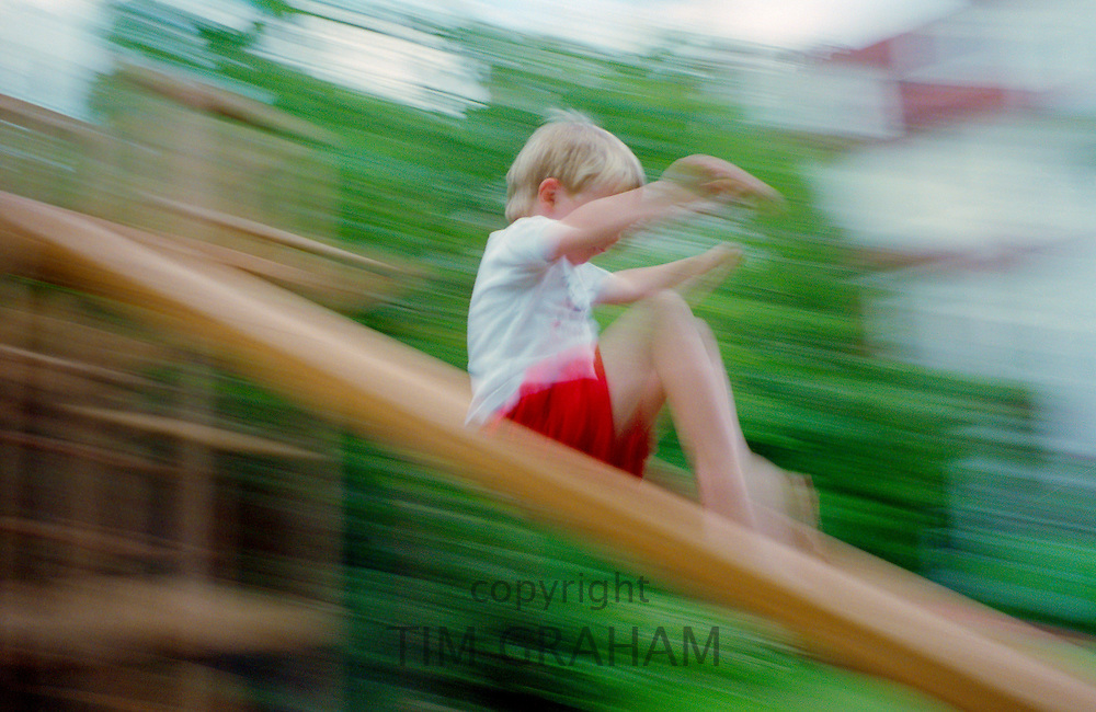 Child slipping down a slide