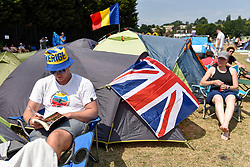© Licensed to London News Pictures. 06/07/2018. LONDON, UK. A man wears a Sweden sunhat whilst queuing for day tickets in Wimbledon Park to the Wimbledon Tennis Championships.  Temperatures forecast to approach 30C mean that the majority have taken precautions to protect themselves from the sun by wearing sunglasses and sunhats.  Photo credit: Stephen Chung/LNP