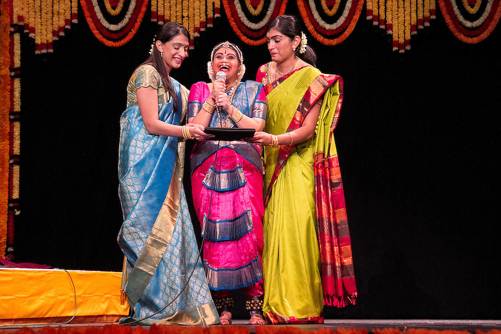 Lincroft, New Jersey, 9/20/14: Hema Ramaswamy, a young Indian American woman with Down syndrome, is flanked by her sisters Uma Shankar and Geetha Radhakrishnan as she thanks the audience after her arangetram performance.