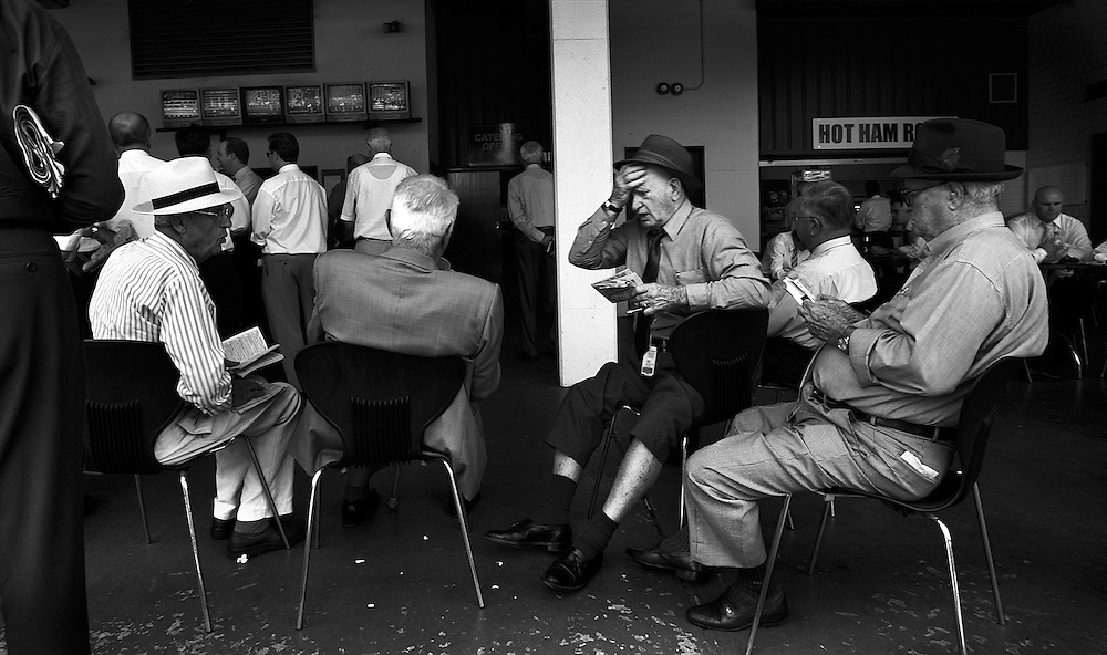 AT THE RACES, Punters look at the form guide, in the members area of Warwick Farm racecourse near Sydney, Australia.