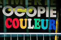 Colorful sign in shop window in Paris