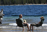 Ferd Schlapper and Deb Garton of Minneapolis, MN soak their feet in the cool waters of Redfish Lake after a hike in the nearby Sawtooth Mountains in central Idaho near the town of Stanley on Saturday July 13, 2013.. The couple was married in Stanley in 2007 and have come back to visit each summer.