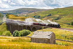© Licensed to London News Pictures. 31/07/2018. Cowgill UK. The 1942 Locomotive Stanier Class 48151 pulls the Dalesman over Arten Gill viaduct in the village of Cowgill in the Yorkshire Dales on route from York to Carlisle. Photo credit: Andrew McCaren/LNP