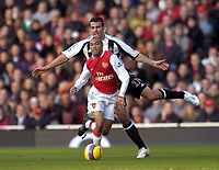 Photo: Olly Greenwood.<br />Arsenal v Newcastle United. The Barclays Premiership. 18/11/2006. Arsenal's Gael Clichy and Newcastle's Peter Ramage
