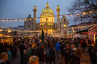 Vienna, Austria- November 22, 2014: Locals and tourists, bunded up in scarves and sipping gluhvein, flock to the holiday markets that engulf much of the city.  CREDIT: Chris Carmichael for The New York Times