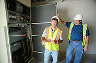 Bob Maloney (left), Operations Director for Bristol Township School District and BK Horner, onsite construction manager for Reynolds Construction shows the new heating system in one of the classrooms at the under construction elementary school Wednesday August 5, 2015 in Bristol, Pennsylvania. (Photo by William Thomas Cain/Cain Images)