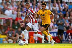 Tom Ince of Stoke City goes past Morgan Gibbs of Wolverhampton Wanderers - Mandatory by-line: Robbie Stephenson/JMP - 25/07/2018 - FOOTBALL - Bet365 Stadium - Stoke-on-Trent, England - Stoke City v Wolverhampton Wanderers - Pre-season friendly