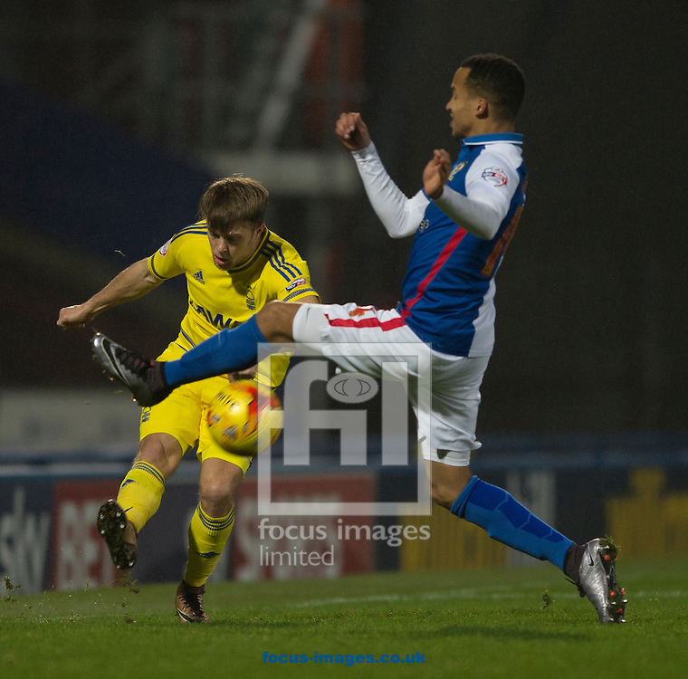 Jamie Ward of Nottingham Forest (left) plays the ball forward as Marcus Olsson of Blackburn Rovers closes down during the Sky Bet Championship match at Ewood Park, Blackburn<br /> Picture by Russell Hart/Focus Images Ltd 07791 688 420<br /> 14/12/2015