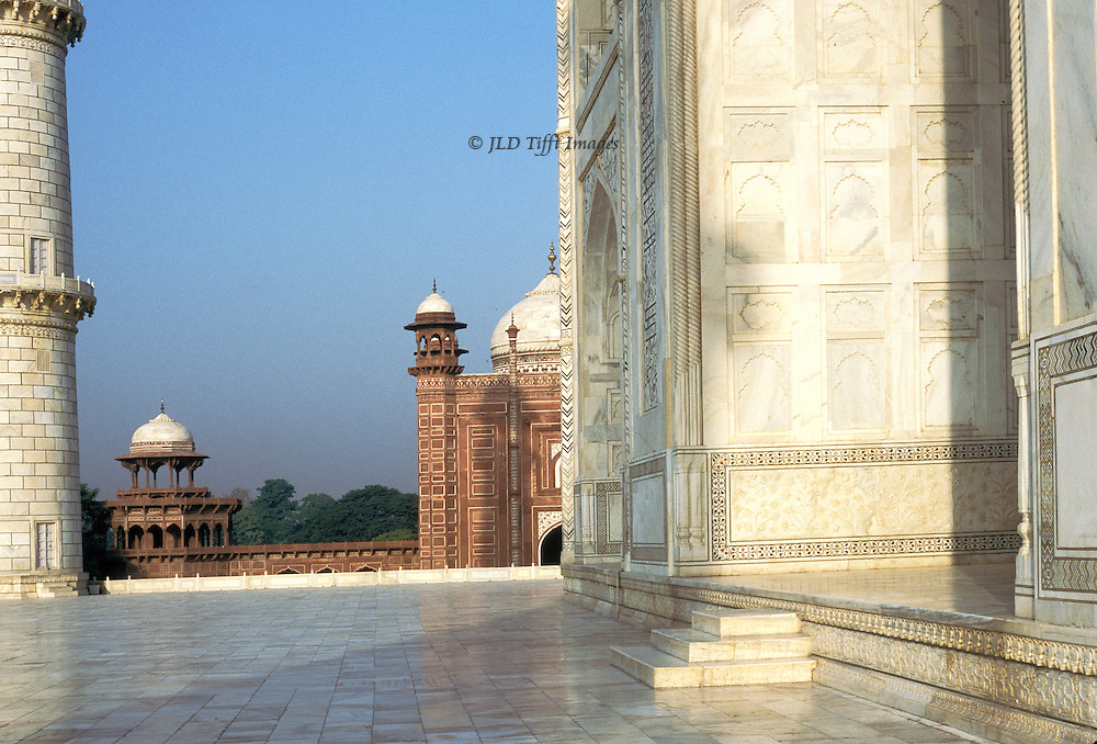 Taj Mahal terrace, looking toward the guest house next to the tomb structure.  White marble and red sandstone in contrast.